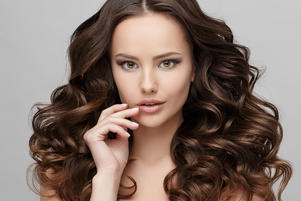 Woman With Curly Brunette Hair Extensions