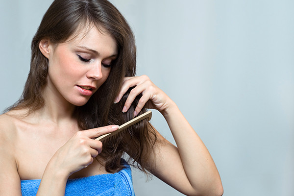 Girl Combing Her Hair Extensions