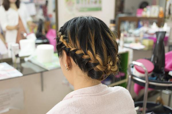 long braid creative brown hair style in salon beauty