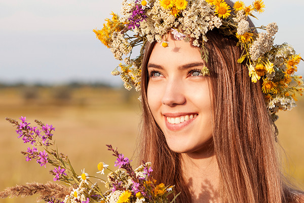 Woman Wearing Hair Extensions With A Flower Crown