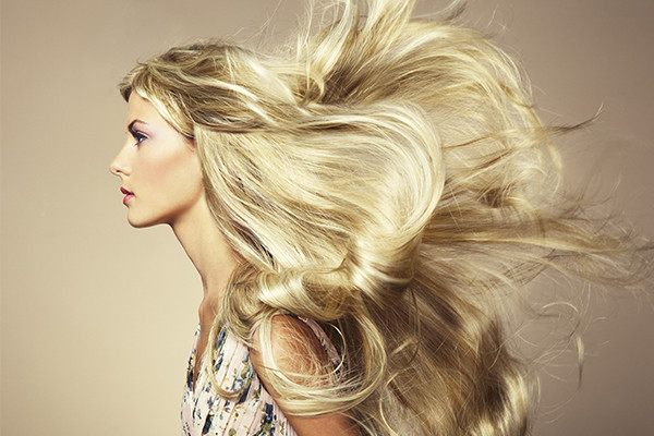 Woman With Healthy Hair and Hair Extensions