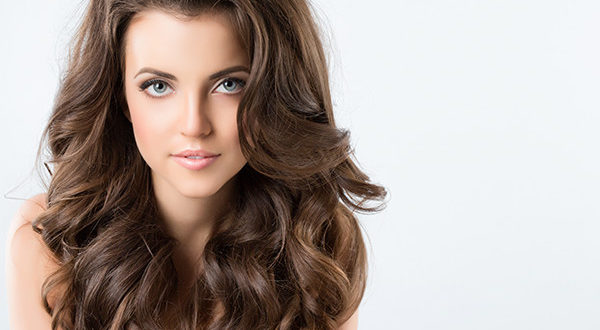 Lady with curly, beautiful hair extensions