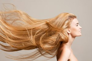 Lady with very long strawberry blond hair flowing in the wind