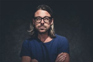 Trendy guy with long hair and glasses