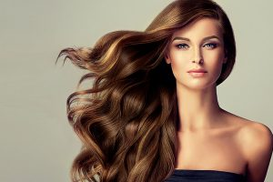 Woman With Long Hair Using Hair Extensions