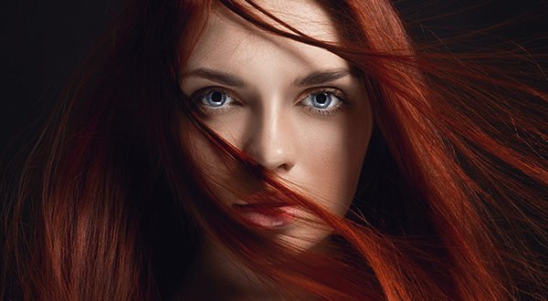 Red Haired Woman Using Tape In Hair Extensions 3-18