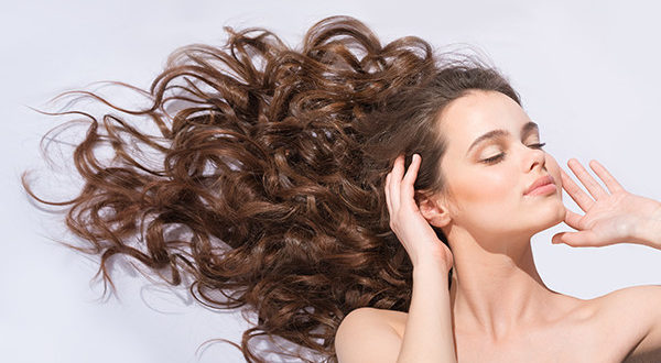 Womans Hair Flowing Using Hair Extensions