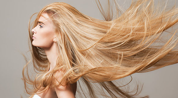 Bloned Haired Woman With Long Hair Extensions